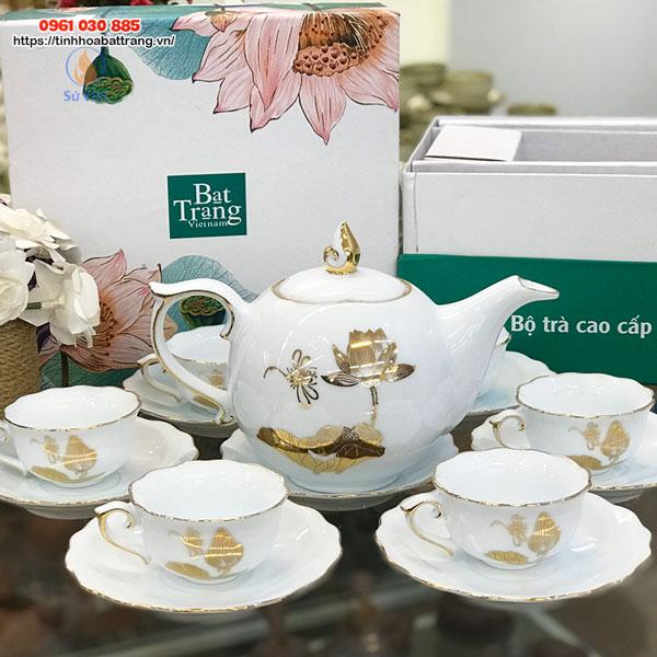 Bộ trà trắng mẫu đơn vẽ sen chuồn kẻ vàng kim